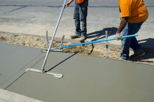 Workers laying concrete for a foundation in Winter Park
