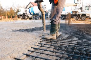 Concrete worker laying a commercial foundation for a business in Winter Park